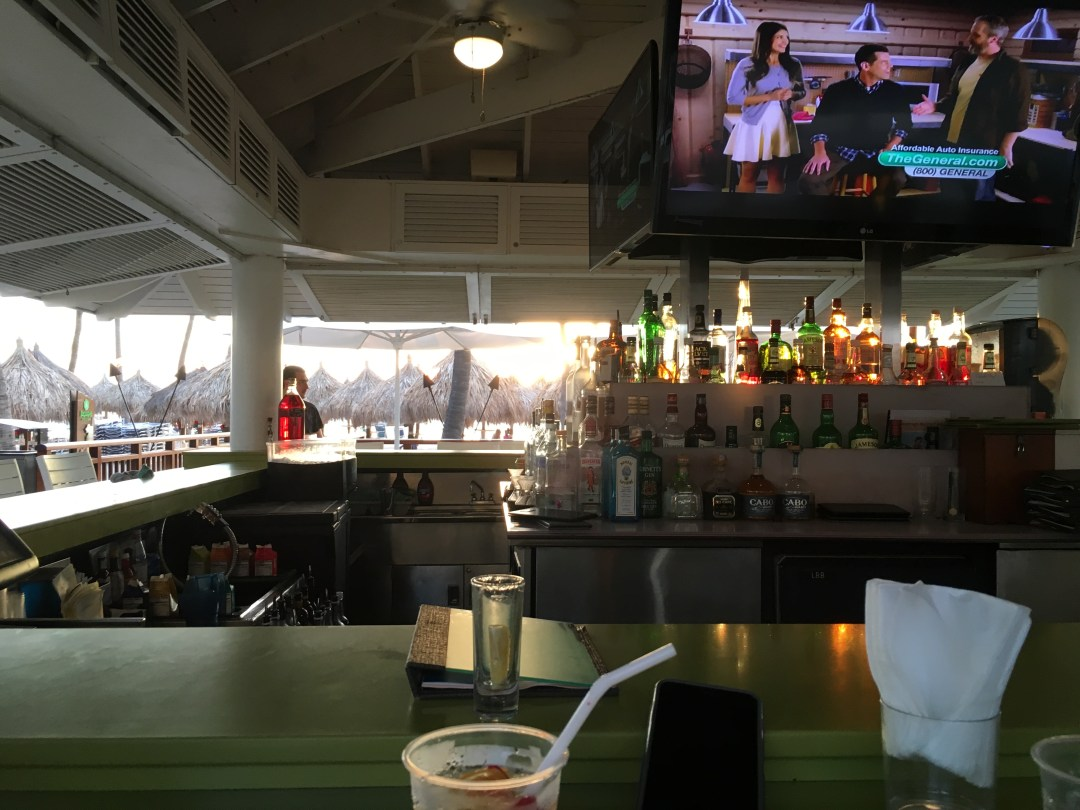 Sip on a beverage and watch your favorite sports teams play at the Palms Beach bar