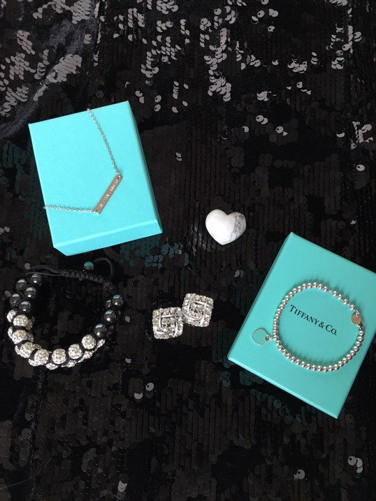 Necklace (top left) from Jewelry Hills Etsy Shop. Bracelet (bottom right) from Tiffany's. Earrings (middle) are vintage.
