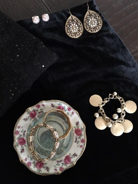 Pink and gold bracelet (bottom left) is from Younkers Department Store.