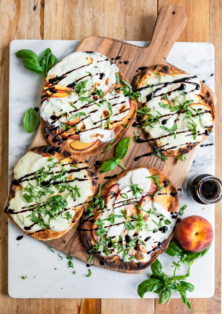 This Grilled Peach Caprese Naan Pizza Is the Ultimate Easy Summer Meal