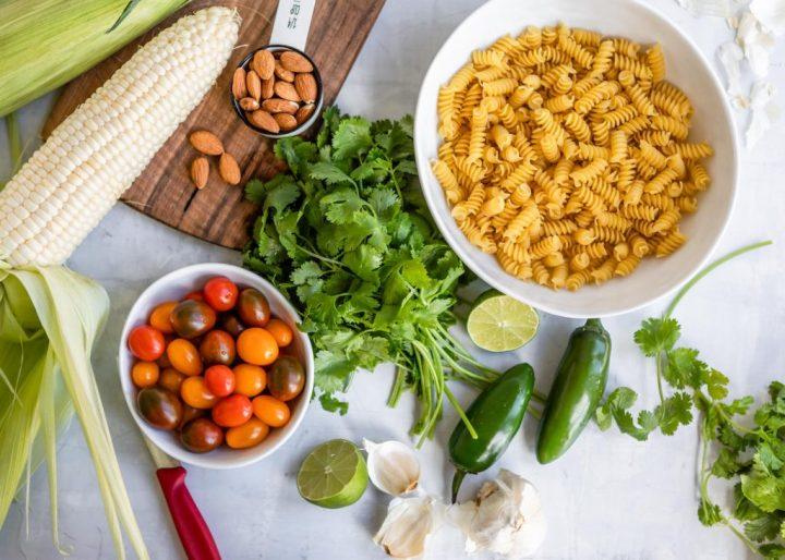 Jalepeno Cilantro Pesto Rotini with Corn and Grape Tomatoes | HelloVeggie.co
