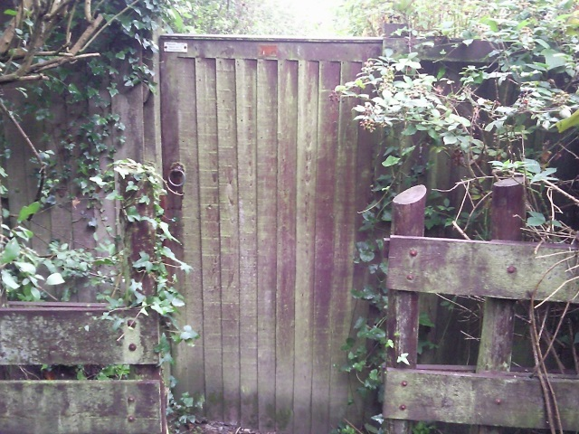 A wooden gate across the path