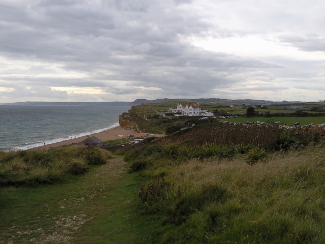 Westward view along the coast from Burton Bradstock; the high point of Golden Cap can be seen in the distance