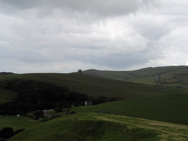 A terraced hill with a chapel on it
