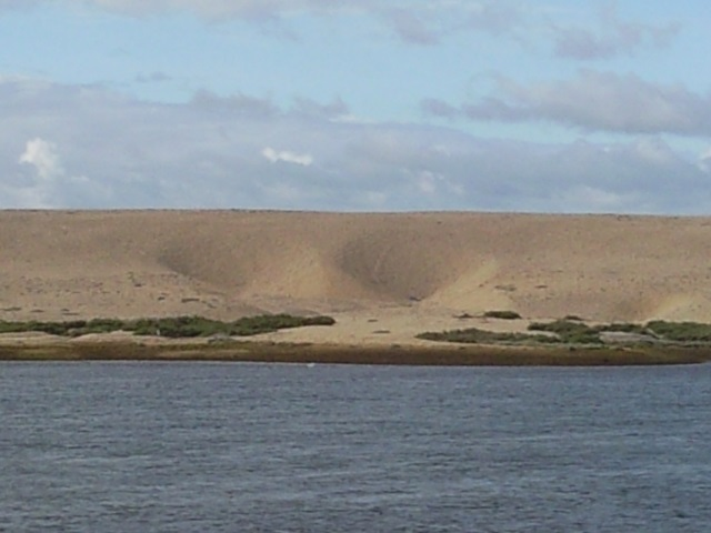 Two crater-like depressions in the shingle bank of Chesil Beach