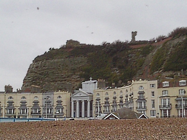 Hastings Castle on the cliff top with other buildings underneath