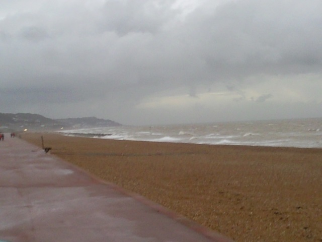 A shingle beach in awful weather.