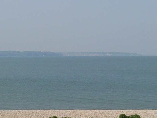 Isle of White vaguely visible through the sea haze from Lee-on-the-Solent