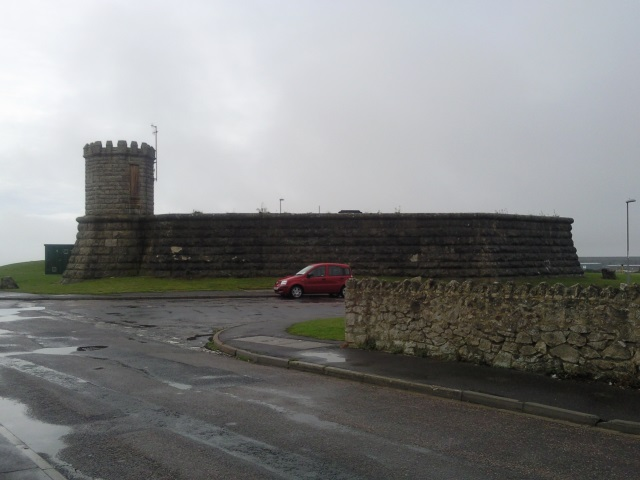 A reservoir with a small castellated tower