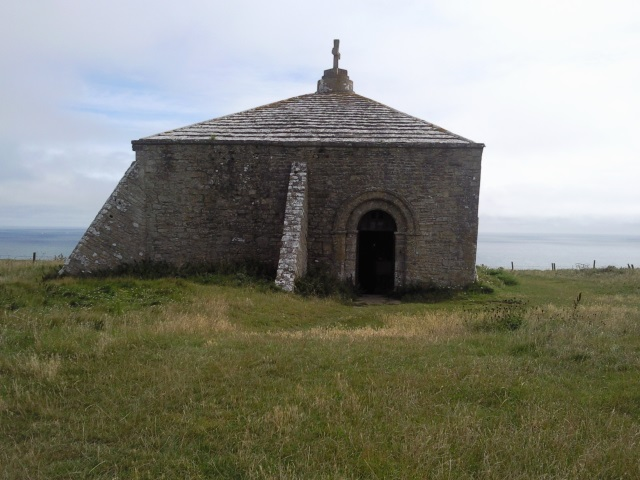 A small stone chapel with an arched doorway