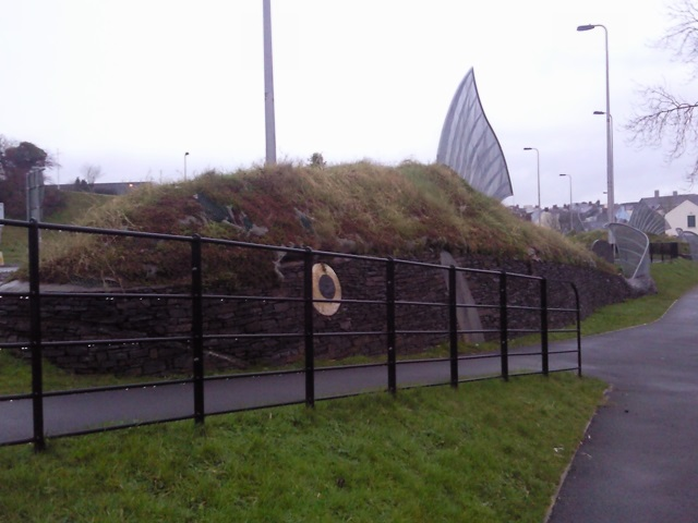 A grass embankment styled to look like a fish