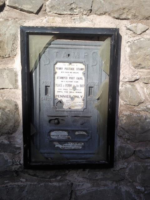 An old pre-decimal stamp dispenser