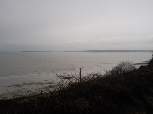 A distant, hazy view of Caldey island, Tenby and Saundersfoot
