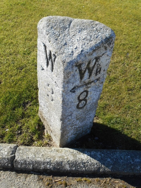 A milestone showing 3 miles to 'W' and 8 miles to 'Wh'.