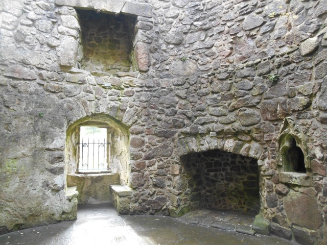 Orchardton Tower interior, featuring a large fireplace