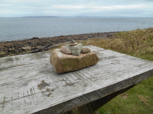 Micro-cairn on a picnic table