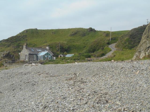 Saltpans cottage beside the shingle beach