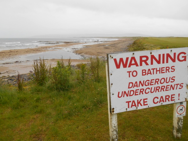 Sign at Machrihanish Bay: warning to bathers, danerous undercurrents, take care.