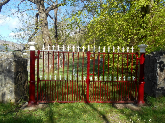 Red gates with a barrier behind