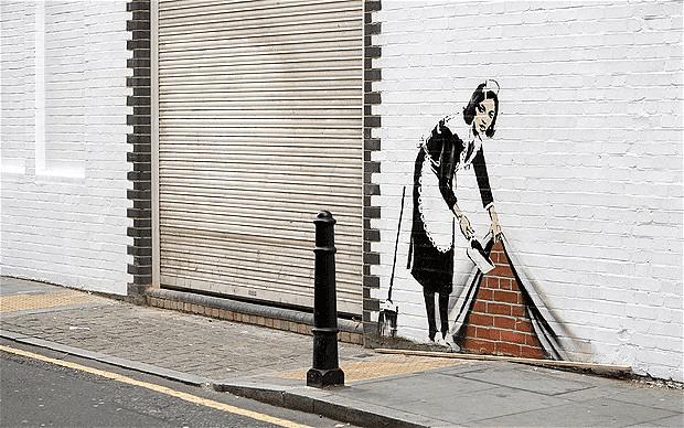 Banksy-Maid Sweeps Up