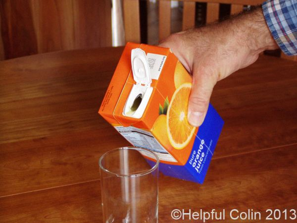 spilling juice from cartons