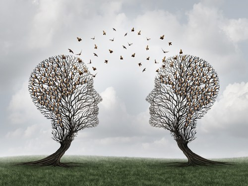 Picture of trees like heads and birds flying