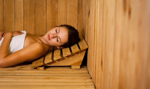 Picture of a woman lying down in a sauna