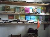 A part of the office with books displayed on the wall