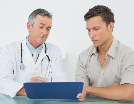 doctor-discussing-reports-with-patient-at-office_13339-89187