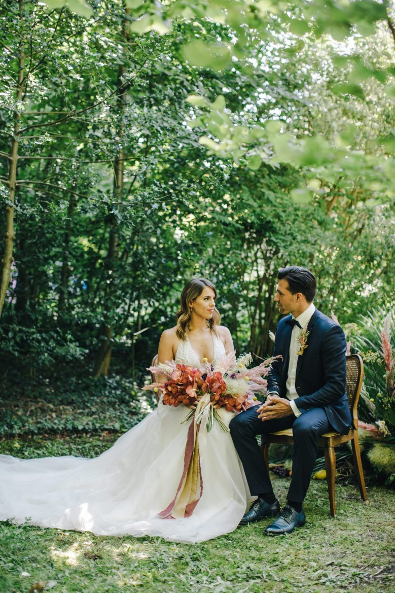 Admire the lush greenery, colorful florals, and elegant timelessness of this Winterthur, Switzerland greenhouse bridal inspiration shoot.