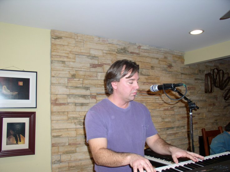 Mike laying down keyboards for Angel
