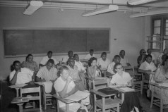 Classroom. Unidentified men and women seated at desks in classroom, ca. 1947. Paul Henderson, HEN.00.B2-250.