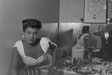 Actress and singer Pearl Bailey (1918-1990) in her dressing room of unidentified club, circa 1946. Paul Henderson, HEN.00.A2-247.