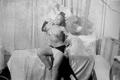 Unidentified female dancer wearing feathers, circa 1948. Paul Henderson, HEN.00.A2-251.