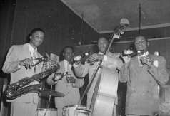 Four musicians with instruments holding Arrow Beer, circa 1951. Paul Henderson, HEN.00.A2-255.