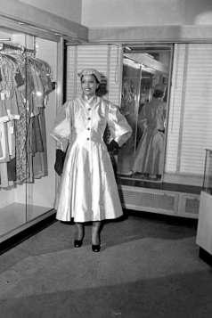 Unidentified woman inside clothing store, circa 1951. Paul Henderson, HEN.00.B1-107.