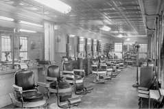 Interior of empty, unidentified barbershop, circa 1949. Paul Henderson, HEN.00.B1-114.