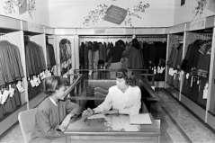Interior of clothing store, circa 1949. Paul Henderson, HEN.00.B1-124.