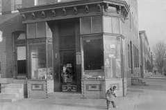 Exterior view of Phillip's Groceries. Shows child standing on sidewalk, undated. Paul Henderson, HEN.00.B1-131.