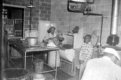 Interior view of kitchen of delicatessen or restaurant, circa 1953. Paul Henderson, HEN.00.B1-137.