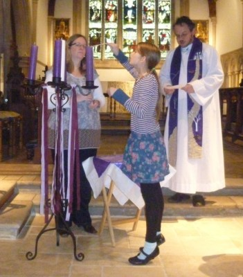 Lighting the first Advent candle.