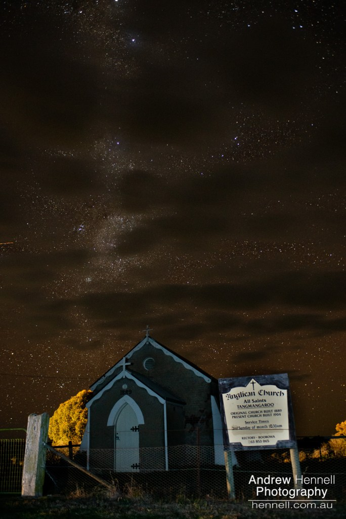 Tangmangaroo Anglican Church under the Milky Way as clouds roll in