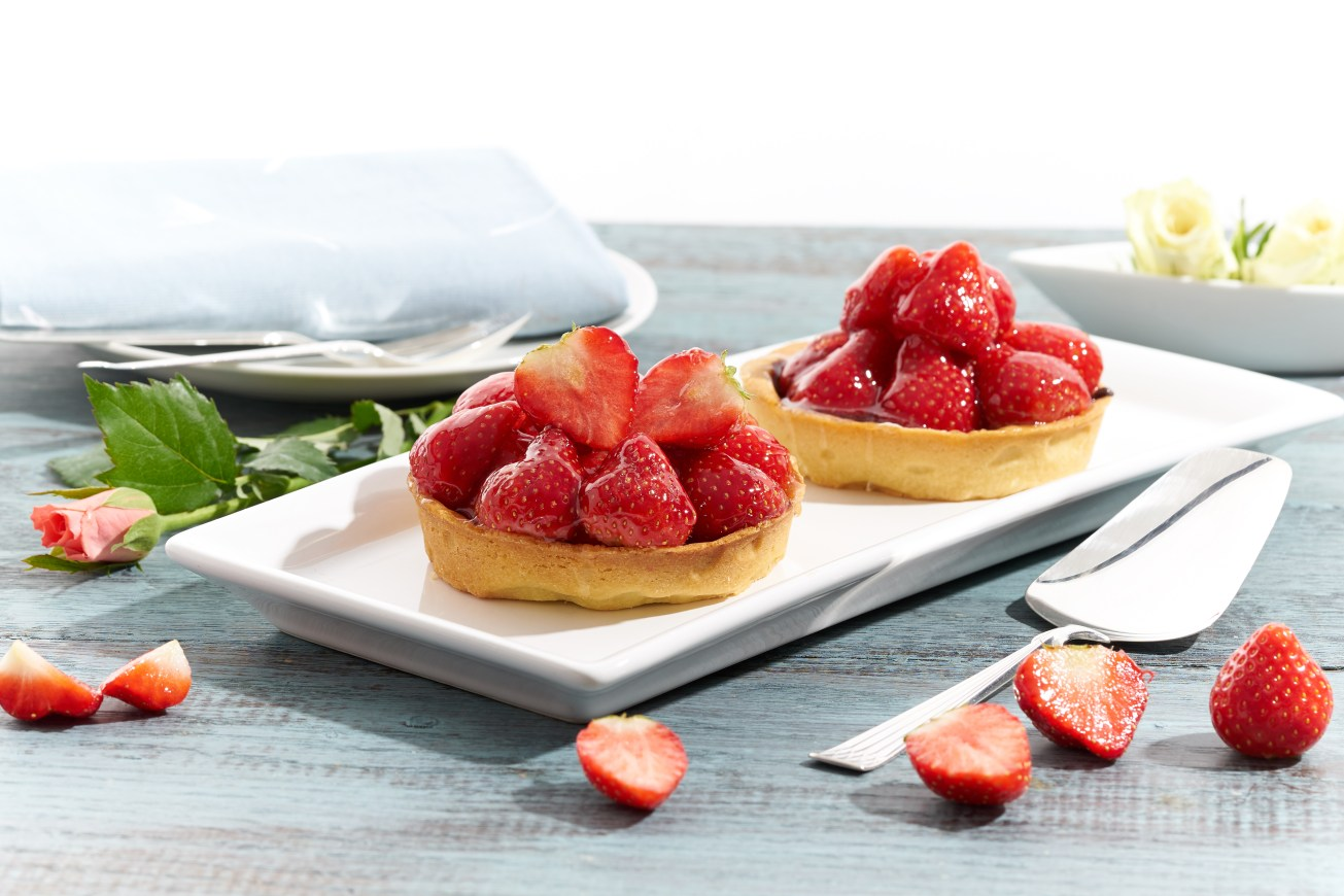 Food photography of strawberry tarts