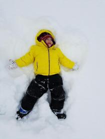 Mrs. Taylor's son, James making snow angels.