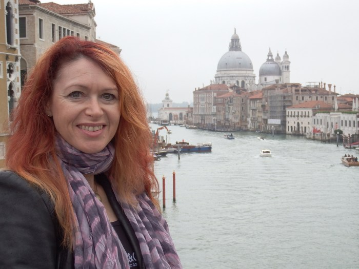 Roz Morris with the Grand Canal and Santa Maria della Salute behind.
