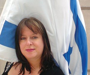 Julie-Burchill-with-Israeli-Flag.jpg