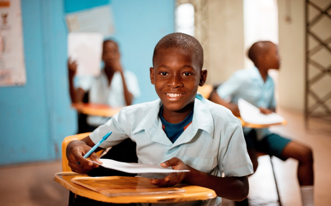 Smiling school kid happy to learn - Ben White @ Unsplash