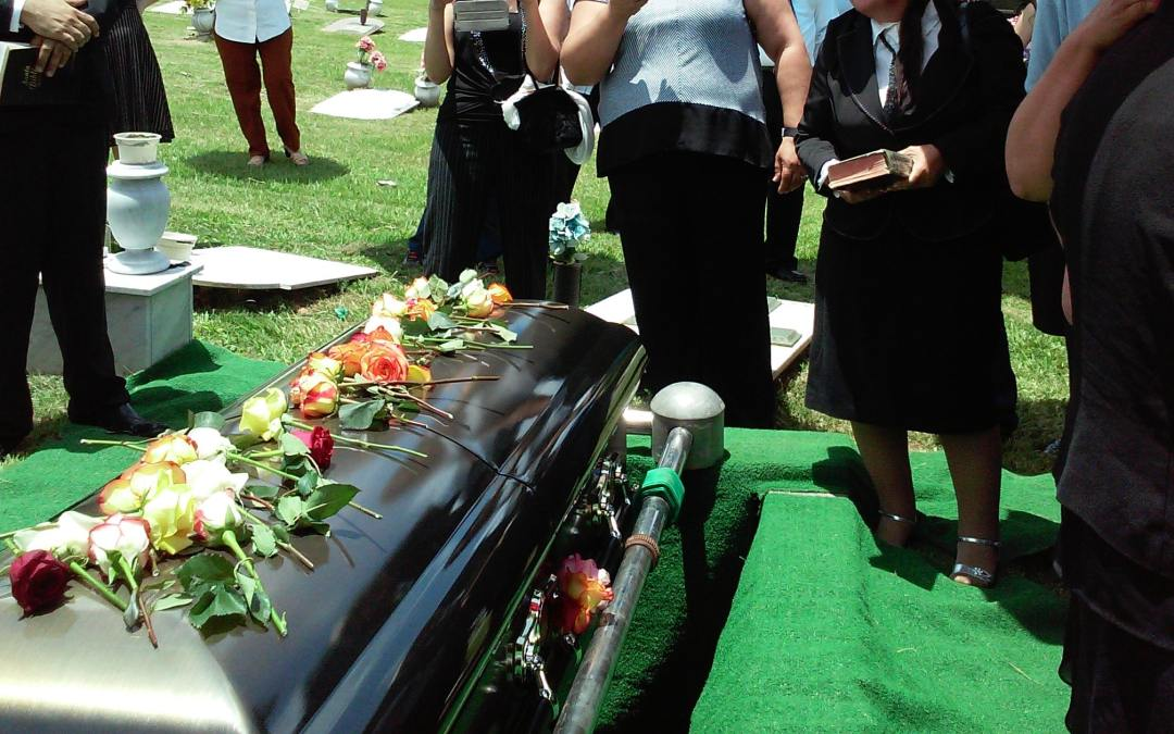 rhodi lopez - funeral - expensive casket being lowered into the ground - unsplash