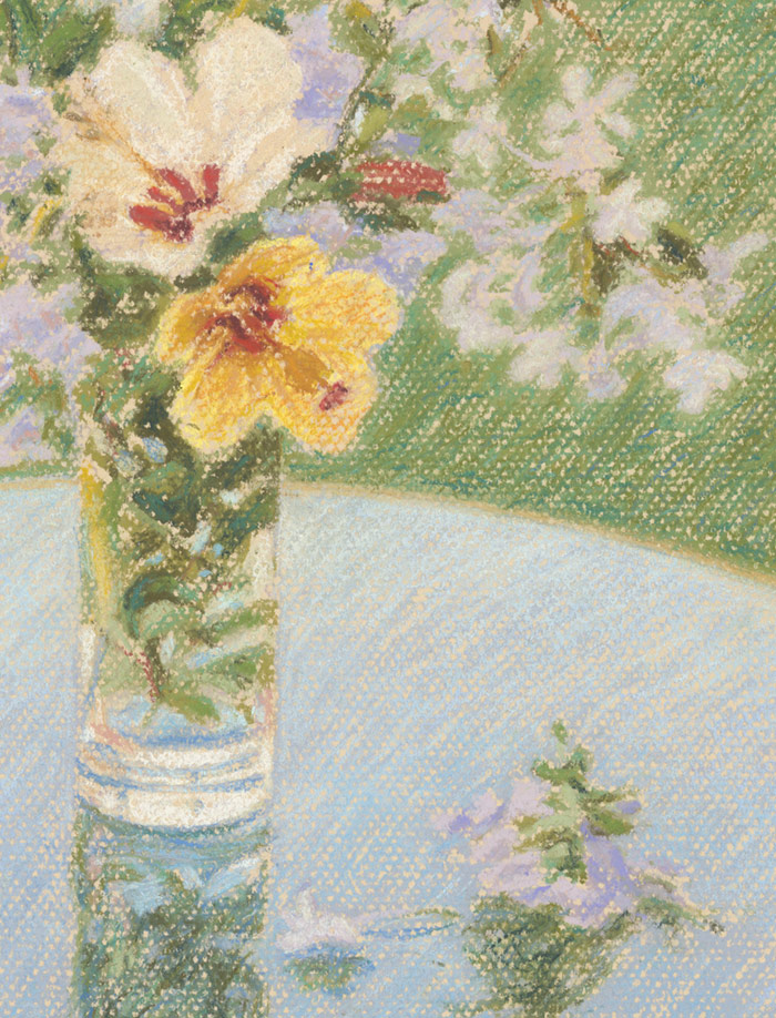 Detail of Spanish Wildflowers on a glass table.