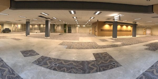 Carpet tiles are removed before construction.